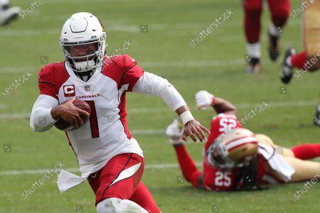 Stock Image of Arizona Cardinals quarterback Kyler Murray (1) runs past San Francisco 49ers cornerback Richard Sherman (25) to score a touchdown during the second half of an NFL football game in Santa Clara, Calif