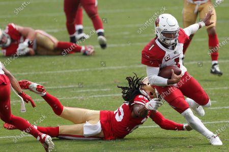 Arizona Cardinals quarterback Kyler Murray (1) runs past San Francisco 49ers cornerback Richard Sherman to score a touchdown during the second half of an NFL football game in Santa Clara, Calif