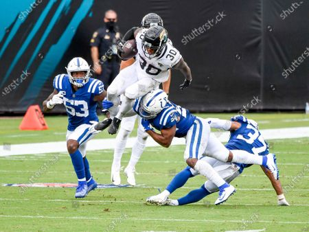 Jacksonville, FL, U.S: Jacksonville Jaguars running back James Robinson (30) leaps over Indianapolis Colts linebacker Anthony Walker (54) during 2nd half NFL football game between the Indianapolis Colts and the Jacksonville Jaguars. Jaguars defeated the Colts 27-20 at TIAA Bank Field in Jacksonville, Fl