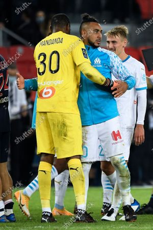 Olympique Marseille's goalkeeper Steve Mandanda (L) celebrates with teammate Dimitri Payet (R) after winning the French Ligue 1 soccer match between Paris Saint-Germain (PSG) and Olympique Marseille at the Parc des Princes stadium in Paris, France, 13 September 2020.