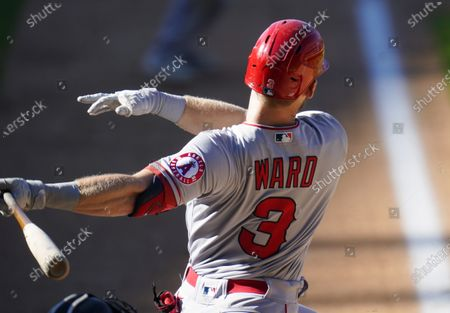 Stock Photo of Los Angeles Angels' Taylor Ward connects for an RBI-single off Colorado Rockies starting pitcher Jeff Hoffman in the ninth inning of a baseball game, in Denver