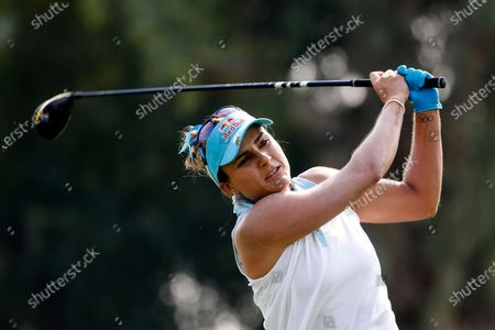 Lexi Thompson watches her tee shot on the third hole during the final round of the LPGA's ANA Inspiration golf tournament at Mission Hills Country Club in Rancho Mirage, Calif