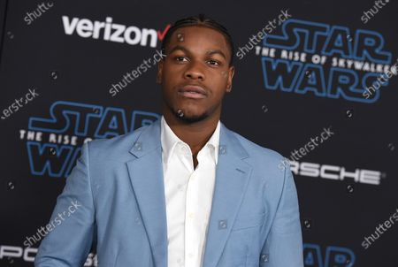 "John Boyega arrives at the world premiere of ""Star Wars: The Rise of Skywalker"" in Los Angeles. British perfume brand Jo Malone has apologized to Black actor John Boyega of ""Star Wars"" fame after cutting him out of the Chinese version of a cologne commercial he helped create"