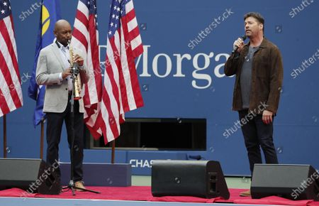 Branford Marsalis (L) and Harry Connick, Jr. perform 'America the Beautiful' prior to the start of the Men's Final match on the fourteenth day of the US Open Tennis Championships the USTA National Tennis Center in Flushing Meadows, New York, USA, 13 September 2020. Due to the coronavirus pandemic, the US Open is being played without fans and runs from 31 August through 13 September.