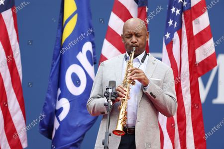Stock Photo of Branford Marsalis performs 'America the Beautiful' prior to the start of the Men's Final match on the fourteenth day of the US Open Tennis Championships the USTA National Tennis Center in Flushing Meadows, New York, USA, 13 September 2020. Due to the coronavirus pandemic, the US Open is being played without fans and runs from 31 August through 13 September.