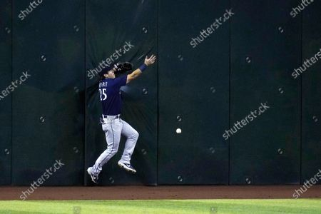 Seattle Mariners center fielder Dylan Moore is unable to make a catch on a run-scoring double hit by Arizona Diamondbacks' Josh VanMeter during the first inning of a baseball game, in Phoenix