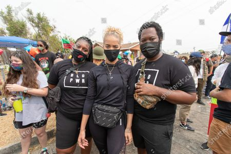 Ty Bryant, Jasmine Sanders and Philip Andrews attend a solidarity protest for Dijon Kizzee after he is killed by the Los Angeles County Sheriff's Department