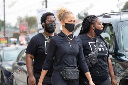 Philip Andrews, Jasmine Sanders and Ty Bryant attend a solidarity protest for Dijon Kizzee after he is killed by the Los Angeles County Sheriff's Department