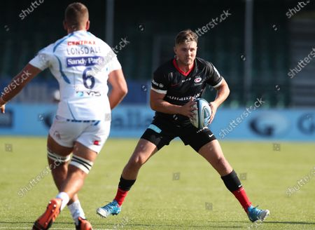 Harry Sloan of Saracens runs at Sean Lonsdale of Exeter