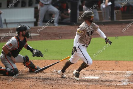 San Diego Padres' Greg Garcia sprints out of the batters box against the San Francisco Giants during a baseball game, in San Diego
