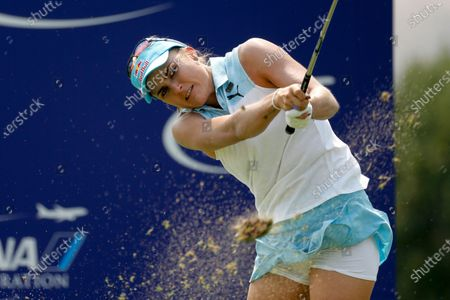 Stock Picture of Lexi Thompson watches her tee shot on the 17th hole during the final round of the LPGA's ANA Inspiration golf tournament at Mission Hills Country Club in Rancho Mirage, Calif