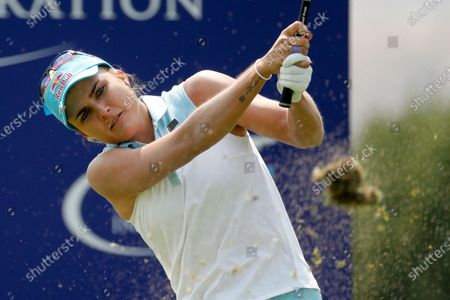 Lexi Thompson watches her tee shot on the 17th hole during the final round of the LPGA's ANA Inspiration golf tournament at Mission Hills Country Club in Rancho Mirage, Calif