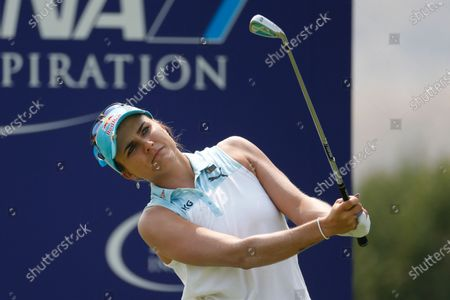Stock Photo of Lexi Thompson watches her tee shot on the 17th hole during the final round of the LPGA's ANA Inspiration golf tournament at Mission Hills Country Club in Rancho Mirage, Calif