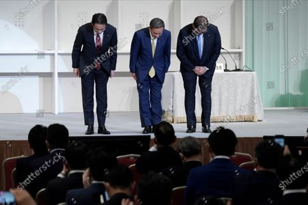 Former foreign Minister Fumio Kishida, left, Japanese Chief Cabinet Secretary Yoshihide Suga and former Defense Minister Shigeru Ishiba, right, bow after Suga was elected as new head of Japan's ruling party at the Liberal Democratic Party's (LDP) leadership election, in Tokyo. The ruling LDP chooses its new leader in an internal vote to pick a successor to Prime Minister Shinzo Abe, who announced his intention to resign last month due to illness