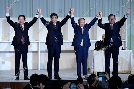 Former Foreign Minister Fumio Kishida, left, Japan's Prime Minister Shinzo Abe, Chief Cabinet Secretary Yoshihide Suga and former Defense Minister Shigeru Ishiba celebrate after Suga was elected as new head of Japan's ruling party at the Liberal Democratic Party's (LDP) leadership election, in Tokyo. The ruling LDP chooses its new leader in an internal vote to pick a successor to Prime Minister Shinzo Abe, who announced his intention to resign last month due to illness