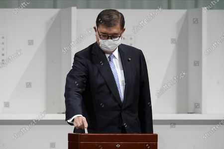 Former Defense Minister Shigeru Ishiba casts his ballot at the Liberal Democratic Party's (LDP) leadership election, in Tokyo. The ruling LDP chooses its new leader in an internal vote to pick a successor to Prime Minister Shinzo Abe, who announced his intention to resign last month due to illness