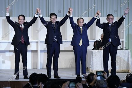 (L-R) Former Foreign Minister Fumio Kishida, Japan's Prime Minister Shinzo Abe, Chief Cabinet Secretary Yoshihide Suga and former Defense Minister Shigeru Ishiba celebrate after Suga was elected as new head of Japan's ruling party during the Liberal Democratic Party's (LDP) leadership election in Tokyo, Japan, 14 September 2020.