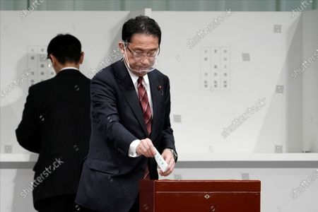 Japan's Foreign Minister Fumio Kishida casts his ballot during the Liberal Democratic Party's (LDP) leadership election in Tokyo, Japan, 14 September 2020.