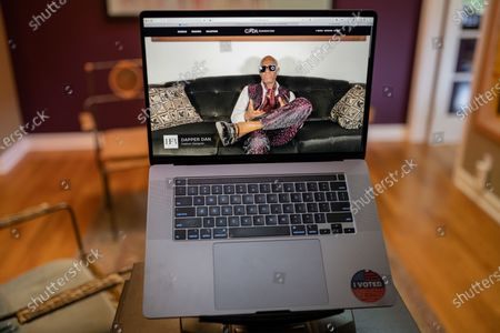 """Stock Picture of Dapper Dan photo illustration viewed on a laptop during the """"Black is the New Black"""" Style Awards and Fashion Show"""