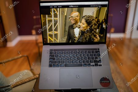 """Stock Photo of Dapper Dan photo illustration viewed on a laptop during the """"Black is the New Black"""" Style Awards and Fashion Show"""