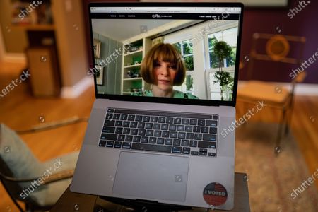 "Anna Wintour photo illustration viewed on a laptop during the ""Black is the New Black"" Style Awards and Fashion Show"