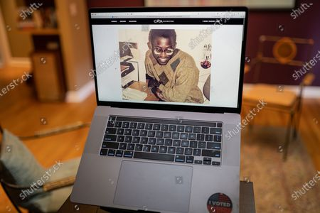 "Edward Enninful photo illustration viewed on a laptop during the ""Black is the New Black"" Style Awards and Fashion Show"