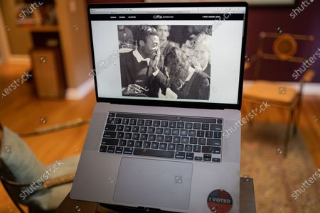 "Stock Image of Edward Enninful photo illustration viewed on a laptop during the ""Black is the New Black"" Style Awards and Fashion Show"