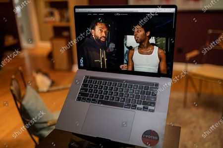 """Stock Photo of Kerby Jean Raymond photo illustration viewed on a laptop during the """"Black is the New Black"""" Style Awards and Fashion Show"""