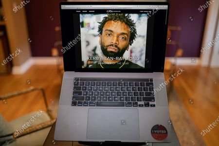 """Kerby Jean Raymond photo illustration viewed on a laptop during the """"Black is the New Black"""" Style Awards and Fashion Show"""