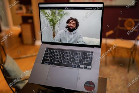 """Stock Picture of Kerby Jean Raymond photo illustration viewed on a laptop during the """"Black is the New Black"""" Style Awards and Fashion Show"""