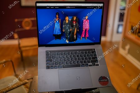 "Kimberly Goldson runway show photo illustration viewed on a laptop during the ""Black is the New Black"" Style Awards and Fashion Show"
