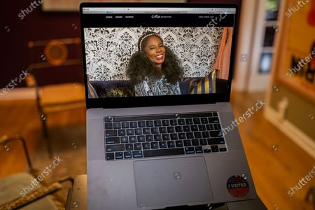 "Kimberly Goldson photo illustration viewed on a laptop during the ""Black is the New Black"" Style Awards and Fashion Show"