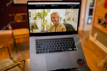 """Maria Cornejo photo illustration viewed on a laptop during the """"Black is the New Black"""" Style Awards and Fashion Show"""