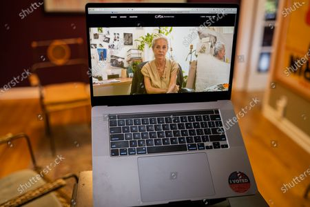 """Stock Photo of Maria Cornejo photo illustration viewed on a laptop during the """"Black is the New Black"""" Style Awards and Fashion Show"""