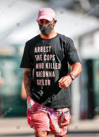 """Lewis Hamilton (GB # 44), Mercedes-AMG Petronas F1 Team with a T-shirt that says """"Arrest the cops who killed Breonna Taylor."""" On the back of the six-time world champion there is also a photo of the dead with the inscription """"Say her name"""""""