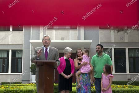 Ambassador to China Terry Branstad, left, speaks during a photocall and briefing to journalists near his family at the Ambassador's residence in Beijing. Branstad appears to be leaving his post, based on tweets by Secretary of State Mike Pompeo. Pompeo thanked Branstad for more than three years of service on Twitter on