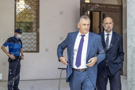 Former Fifa general secretary Jerome Valcke, center, and his lawyer Patrick Hunziker arrive at the Federal Criminal Court in Bellinzona, Switzerland, 14 September 2020. PSG president Al-Khelaifi and former FIFA secretary general Valcke are accused of qualified disloyalty and incitement, falsification of documents and passive bribery. The Office of the Attorney General of Switzerland opened the proceedings in March 2017.