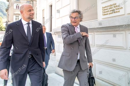 Alec Raymond, the lawyer of Greek businessman, Konstantinos Nteris, right, and Patrick Hunziker, the lawyer of Former Fifa general secretary Jerome Valcke arrive at the Federal Criminal Court in Bellinzona, Switzerland, 14 September 2020. PSG president Al-Khelaifi and former FIFA secretary general Valcke are accused of qualified disloyalty and incitement, falsification of documents and passive bribery. The Office of the Attorney General of Switzerland opened the proceedings in March 2017.