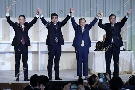 Former Foreign Minister Fumio Kishida, left, Japan's Prime Minister Shinzo Abe, Chief Cabinet Secretary Yoshihide Suga and former Defense Minister Shigeru Ishiba celebrate after Suga was elected as new head of Japan's ruling party at the Liberal Democratic Party's (LDP) leadership election, September 14, 2020, in Tokyo. Tokyo, JAPAN 14 September 2020.