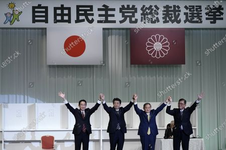 Stock Image of Former Foreign Minister Fumio Kishida, left, Japan's Prime Minister Shinzo Abe, Chief Cabinet Secretary Yoshihide Suga and former Defense Minister Shigeru Ishiba celebrate after Suga was elected as new head of Japan's ruling party at the Liberal Democratic Party's (LDP) leadership election, September 14, 2020, in Tokyo. Tokyo, JAPAN 14 September 2020.