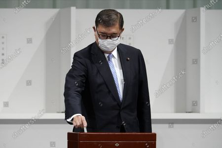 Stock Photo of Former Defense Minister Shigeru Ishiba casts his ballot at the Liberal Democratic Party's (LDP) leadership election  September 14, 2020, in Tokyo. The winner will be de facto elected as Japan Prime Minister. Tokyo, JAPAN 14 September 2020.