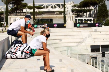 Anett Kontaveit of Estonia and her coach Nigel Sears (L), father-in-law of British player Andy Murray, watch games at the Italian Open in Rome, Italy, 14 September 2020.
