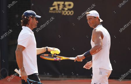 Spanish player Rafael Nadal (R) and his coach Carlos Moya during a practise session at the Italian Open in Rome, Italy, 14 September 2020.
