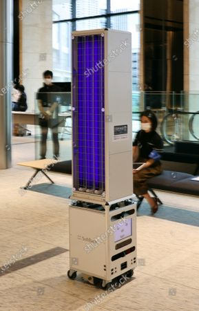 Stock Photo of Japanese IT giant Softbank's delivery robot Cuboid carries ultra violet irradiation devices to disinfect floors for the demonstration at a press previewv of the newly opened Tokyo Portcity Takeshiba building in Tokyo on Monday, September 14, 2020. The building officially opened on September 14 and IT giant Softbank moved its headquarters.
