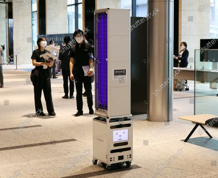 Stock Image of Japanese IT giant Softbank's delivery robot Cuboid carries ultra violet irradiation devices to disinfect floors for the demonstration at a press previewv of the newly opened Tokyo Portcity Takeshiba building in Tokyo on Monday, September 14, 2020. The building officially opened on September 14 and IT giant Softbank moved its headquarters.