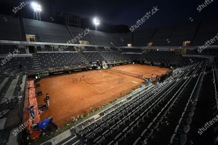 Dayana Yastremska (L) of Ukraine in action against Camila Giorgi (R) of Italy during their women's singles first round match at the Italian Open tennis tournament in Rome, Italy, 14 September 2020.