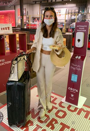 Stock Picture of Exclusive - Lucy Watson returning from a holiday in Thessaloniki, Greece. Lucy got engaged whilst on the holiday.