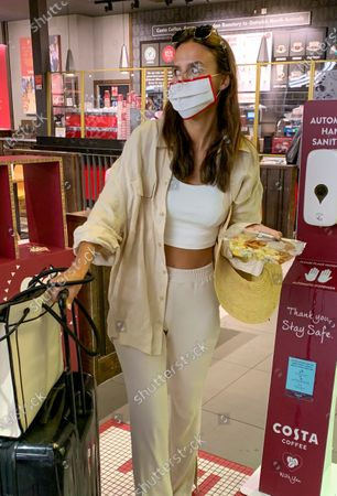 Exclusive - Lucy Watson returning from a holiday in Thessaloniki, Greece. Lucy got engaged whilst on the holiday.