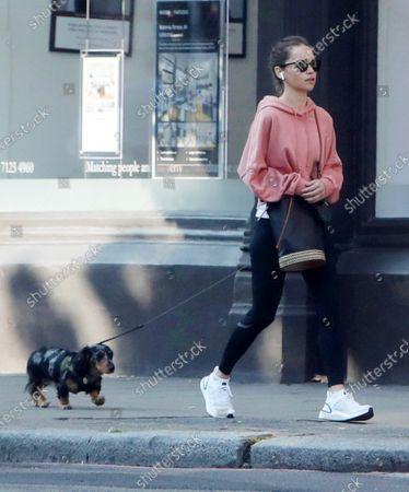 Exclusive - Emilia Clarke walking her dog
