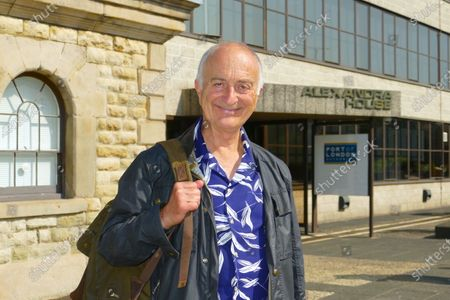 Sir Tony Robinson is pictured as guest of Martin Garside (Director of Public Relations of the Port Of London Authority) as he start production of his new television program on the river Thames.